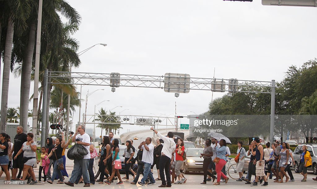 Demonstrators march past the entrance to the Port of Miami following a peaceful rally at the Torch of Freedom in downtown Miami a day after the verdict to the George Zimmerman murder trail on July 14, 2013 in Miami, Florida. A jury found neighborhood watch volunteer, George Zimmerman not guilty of shooting and killing 17-year-old Trayvon Martin after an altercation in February 2012.