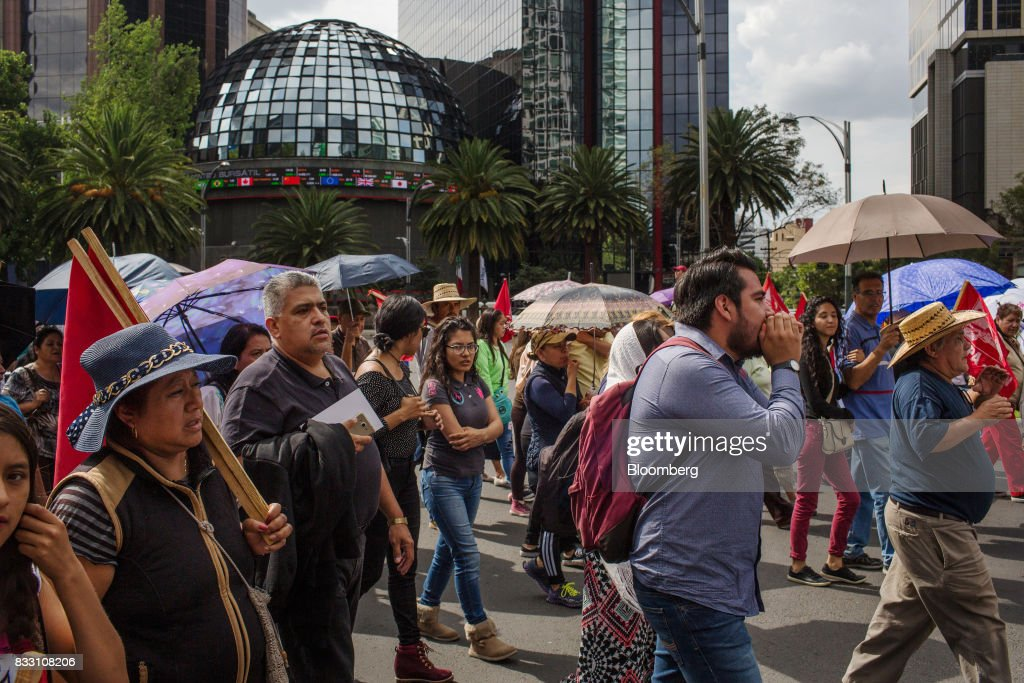Demonstrators march past the Mexican Stock Exchange during a protest against the North American Free Trade Agreement (NAFTA) in Mexico City, Mexico, on Wednesday, Aug. 16, 2017. U.S. Trade Representative Robert Lighthizer made clear Wednesday, on the first day of Nafta renegotiation talks with Mexico and Canada, that the administration will push to win back the jobs and manufacturing capacity the U.S. lost under Nafta. Photographer: Brett Gundlock/ Bloomberg