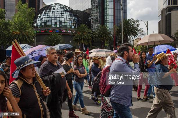 Demonstrators march past the Mexican Stock Exchange during a protest against the North American Free Trade Agreement in Mexico City Mexico on...