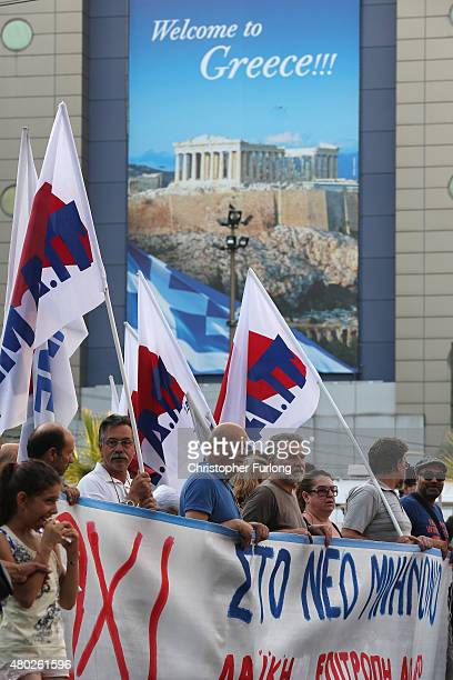 Demonstrators march through Athens during an antiausterity rally ending in front of the Greek parliament where MP's are debating a new budget...