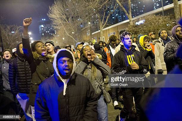 Demonstrators march through downtown following the release of a video showing Chicago Police officer Jason Van Dyke shooting and killing Laquan...
