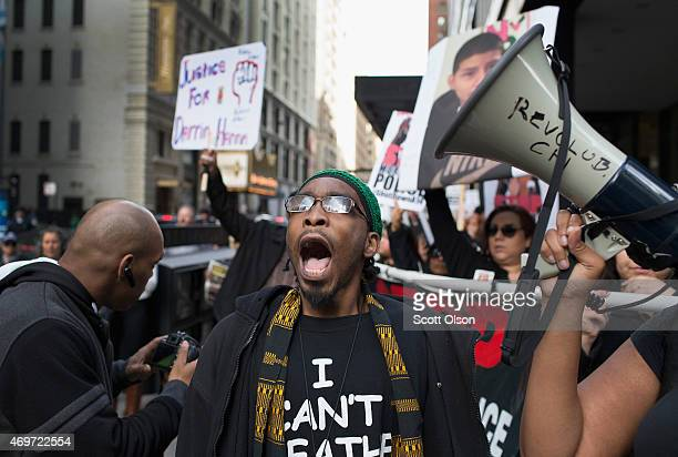 Demonstrators march through the Loop to draw attention to the shooting of unarmed men by police on April 14 2015 in Chicago Illinois The...