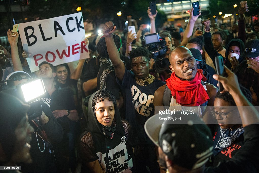 Demonstrators march through the streets during protests September 22, 2016 in Charlotte, North Carolina. Protests began on Tuesday night following the fatal shooting of 43-year-old Keith Lamont Scott at an apartment complex near UNC Charlotte. A state of emergency was declared overnight in Charlotte and a midnight curfew was imposed by mayor Jennifer Roberts, to be lifted at 6 a.m.