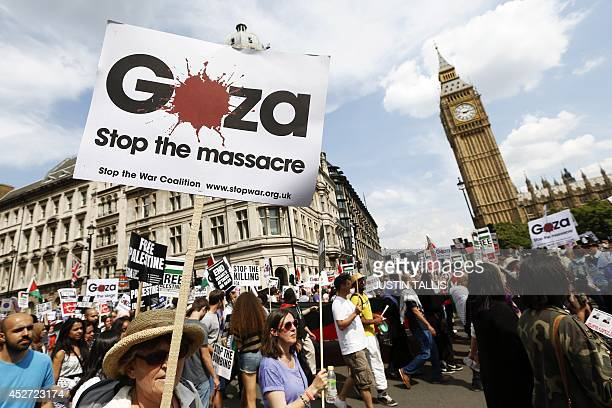 Demonstrators march through the streets from outside the Israeli embassy in central London on July 26 calling for an end to violence in Gaza At least...