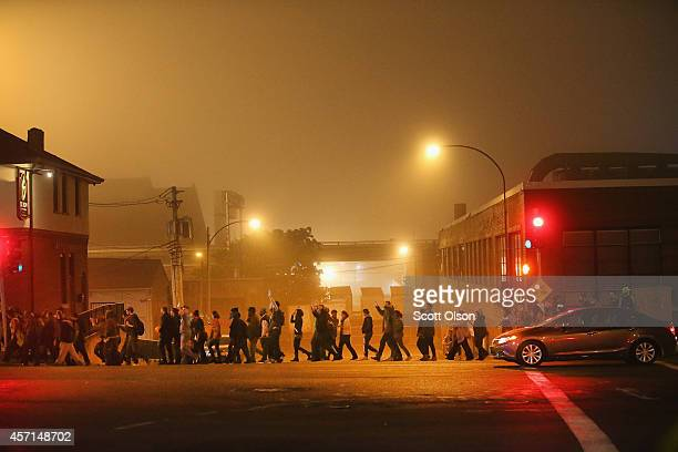 Demonstrators march through the streets on October 13 2014 in St Louis Missouri The St Louis area has been struggling to heal since riots erupted...