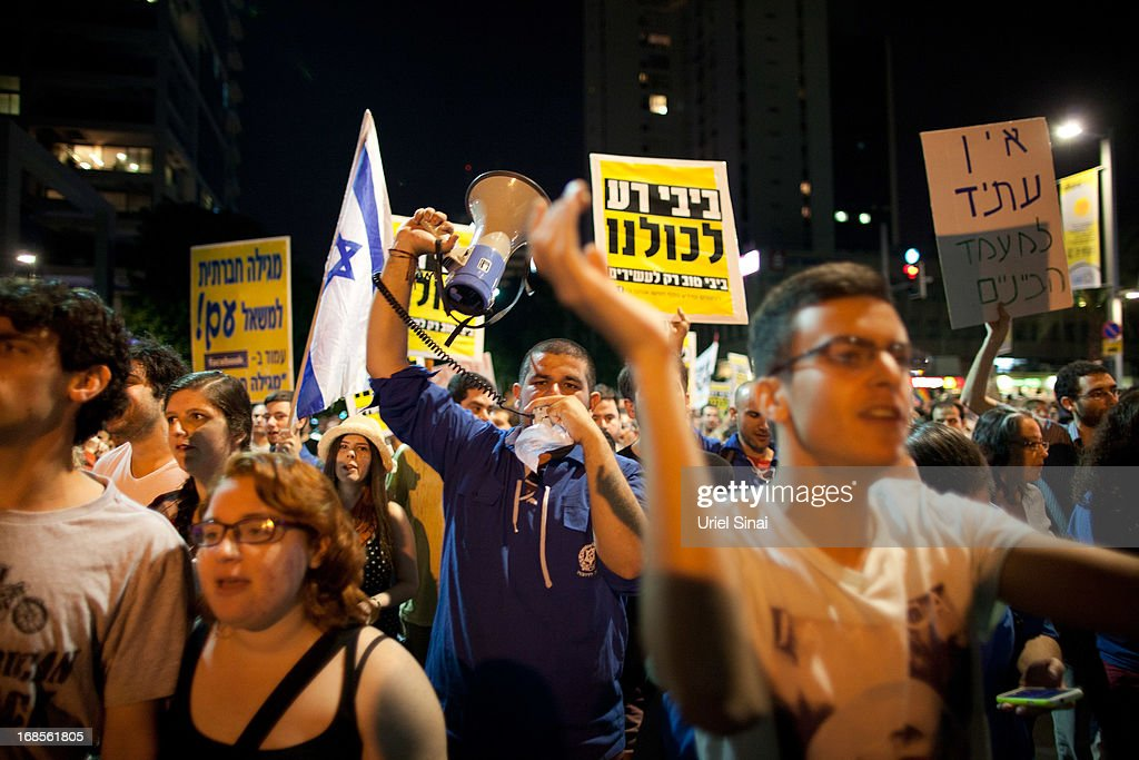 Demonstrators march through the streets to protest against Israeli Finance Minister Yair Lapid's budget cuts on May 11, 2013 in Tel Aviv, Israel. Thousands of Israelis took to the streets to protest against austerity measures presented this week as part of the state's new budget.