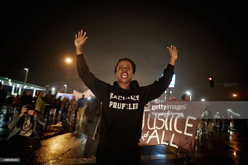 Demonstrators march through the streets while protesting the shooting death of 18-year-old Michael Brown on November 23, 2014 in St. Louis, Missouri. Tensions in Ferguson remain high as a grand jury is expected to decide this month if Ferguson police officer <a gi-track='captionPersonalityLinkClicked' href=/galleries/search?phrase=Darren+Wilson+-+Police+Officer&family=editorial&specificpeople=13495859 ng-click='$event.stopPropagation()'>Darren Wilson</a> should be charged in the shooting death of Michael Brown. November 23, 2014.