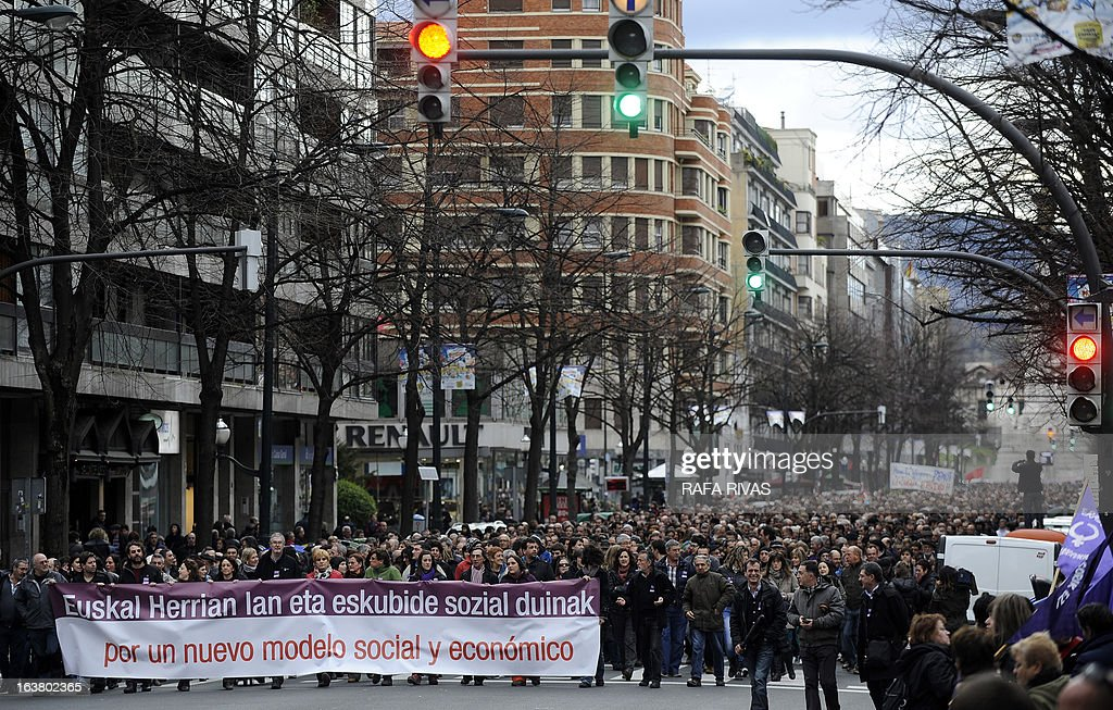 Demonstrators march to protest against Spanish government's austerity measures during a demonstration called by several Basque unions and social collectives in the Northern Spanish Basque city of Bilbao on March 16, 2013. The banner reads in Basque and Spanish 'Decent jobs and social rights in the Basque Country. In favour of a new social and economic model'.