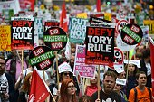 Demonstrators march to protest against the British government's spending cuts and austerity measures in London on June 20 2015 The national...
