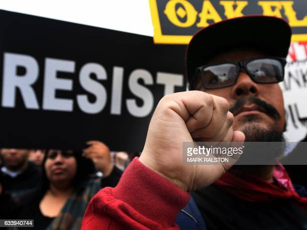 Demonstrators march to the Federal Building in protest against President Donald Trump's executive order fasttracking the Keystone XL and Dakota...