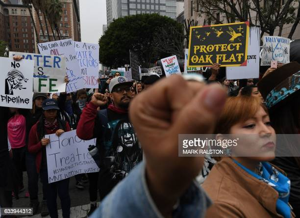 Demonstrators march to the Federal Building in protest against US President Donald Trump's executive order fasttracking the Keystone XL and Dakota...