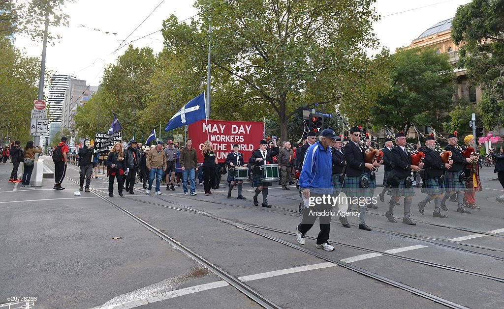Demonstrators march towards city center during a rally to mark May Day, International Workers' Day, in Melbourne, Australia on May 1, 2016.