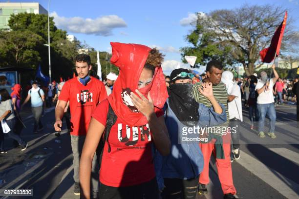 Demonstrators march towards the National Congress during protests demanding the resignation of President Michel Temer in Brasilia Brazil on Wednesday...
