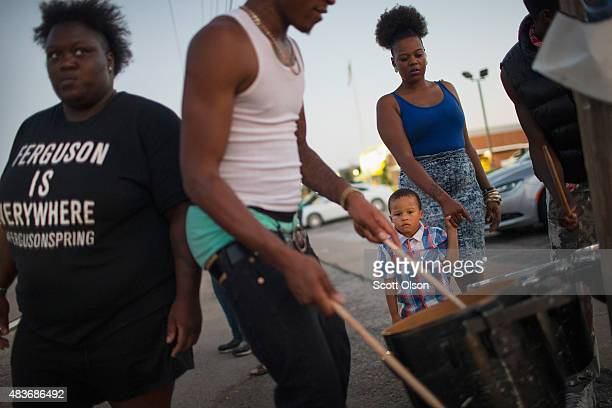 Demonstrators marking the oneyear anniversary of the shooting of Michael Brown protest along West Florrisant Street on August 11 2015 in Ferguson...