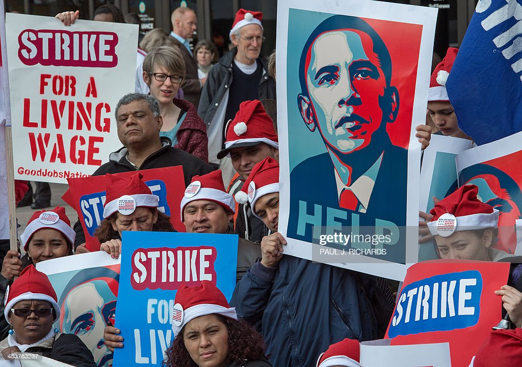 Demonstrators near a McDonald's restaurant outside of the Smithsonian Air and Space Museum as part of a nationwide protest of fast food workers December 5, 2013 in Washington, DC. Fast-food workers say they will sponsor one-day strikes in 100 cities on Thursday and protest activities in 100 additional cities to demand McDonalds, Burger King, Taco Bell, Wendy's and other fast-food restaraunts to pay a 15USD-an-hour wage. AFP Photo/Paul J. Richards