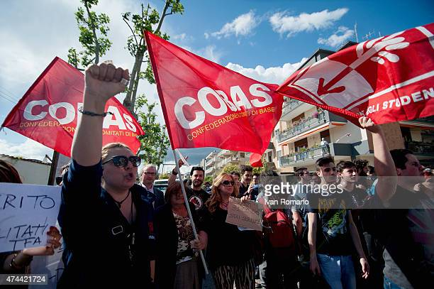 Demonstrators of Cobas Union and students opponents of school reform protest outside the hotel Mediterranea during Italian Prime Minister Matteo...