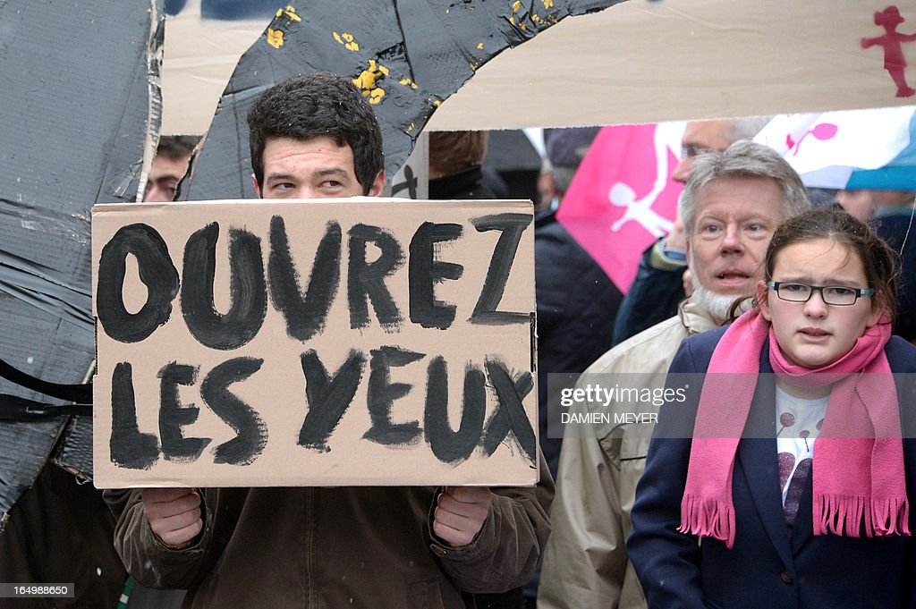 Demonstrators opposed to same-sex marriage demonstrate against France's gay marriage law in an attempt to block legislation that will allow homosexual couples to marry and adopt children, on March 30, 2013 outside Rennes' theatre as a discussion forum is held by French daily newspaper Liberation.
