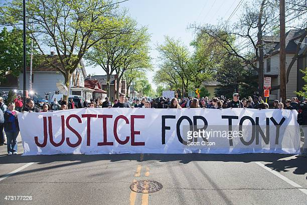 Demonstrators organized by the Young Gifted Black Coalition pass Tony' Robinson's home May 13 2015 in Madison Wisconsin Tony Robinson was killed...