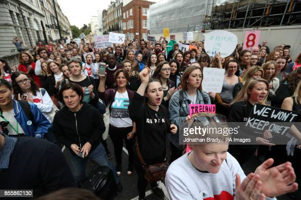 Demonstrators outside the embassy of Ireland on Chapel Street Belgravia London as they take part in the 'London March of Choice' an abortion rights...