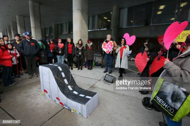 TORONTO ON FEBRUARY 15 Demonstrators outside Toronto City Hall gather around a pinata representing the Gardiner expressway February 15 2017 Toronto...