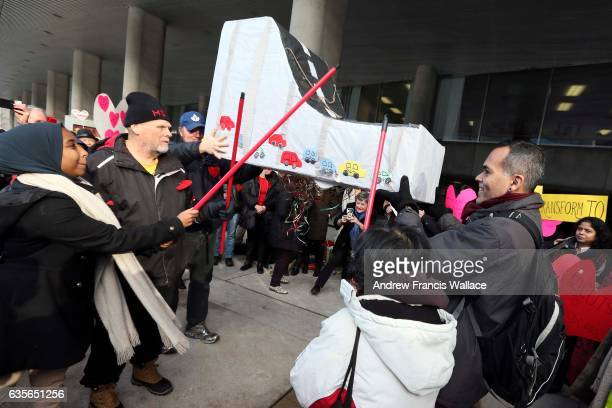 TORONTO ON FEBRUARY 15 Demonstrators outside Toronto City Hall hit a pinata representing the Gardiner expressway February 15 2017 Toronto city...