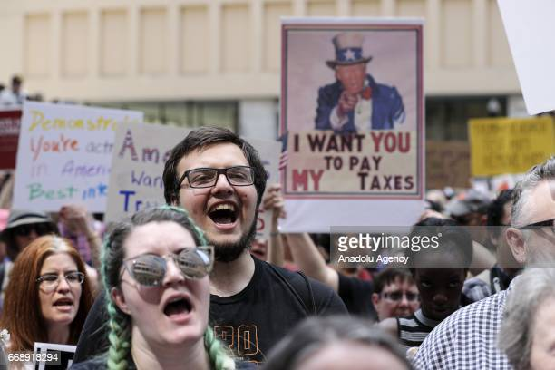 Demonstrators participate in a march and rally to demand President Donald Trump release his tax returns in Chicago Illinois United States on April 15...