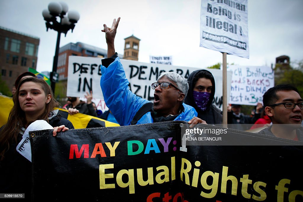 Demonstrators participate in a May Day rally on May 1, 2016 in New York. May Day has shared a date with International Workers' Day since the 1880s. At the time, labor movements around the world were fighting for fair work accommodations like eight-hour workdays and unions. / AFP / KENA