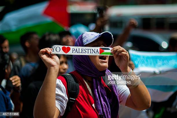 Demonstrators participate in a protest outside the Israeli embassy in San Salvador on July 14 2014 against Israel air strikes on Gaza Israel pressed...