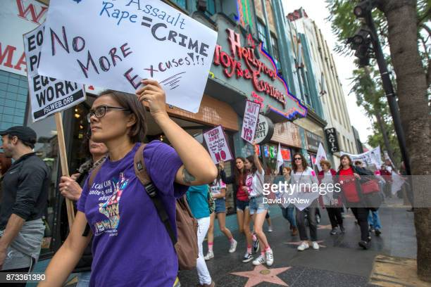 Demonstrators participate in the #MeToo Survivors' March in response to several highprofile sexual harassment scandals on November 12 2017 in Los...