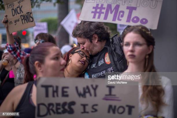 Demonstrators participate in the #MeToo Survivors's March in response to several highprofile sexual harassment scandals on November 12 2017 in Los...
