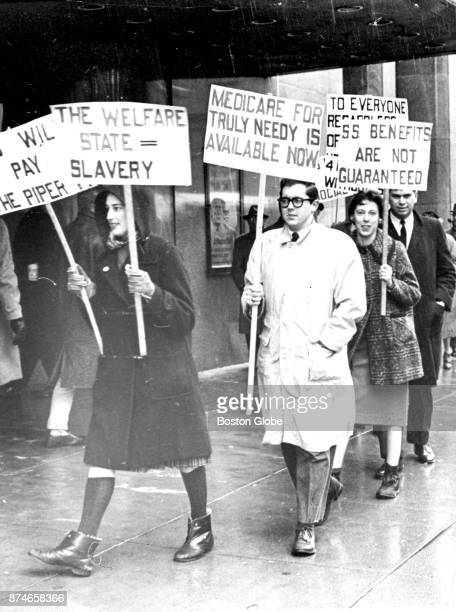 Demonstrators picket outside of John Hancock Hall in Boston as Secretary Abraham A Ribicoff of the US Department of Health Education and Welfare...