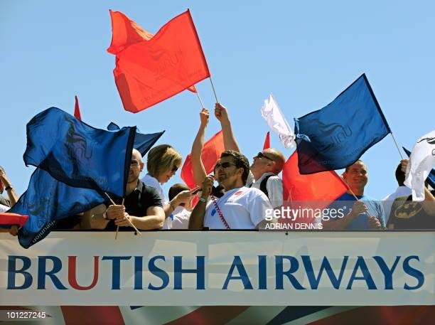Demonstrators prepare to set off on a double decker bus as they take part in a protest for British Airways cabin crew during the first day of a...