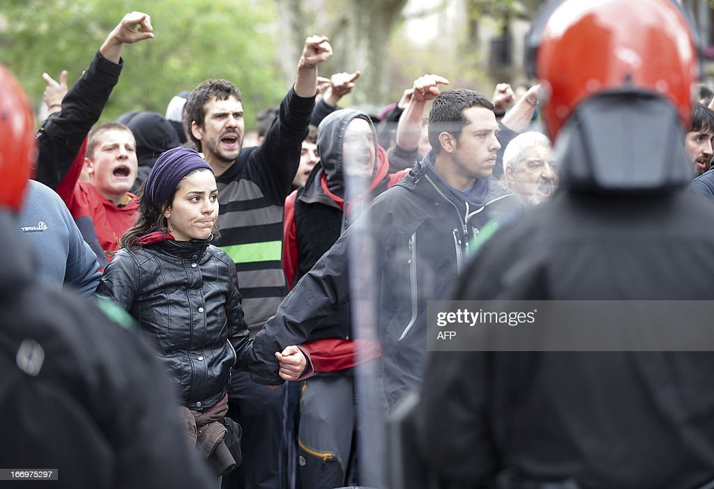 Demonstrators protest after the Ertzaintza Basque Police arrested six members of the Basque pro-independence youth organization SEGI in the northern Spanish Basque city of San Sebastian on April 19, 2013. Hundreds of people have remained gathered in San Sebastian during two days to try to prevent the incarceration of eight members of SEGI sentenced to six years in prison by the Supreme Court. The Spanish Court issued arrest warrants on April 16 against Mikel Arretxe, Imanol Vicente, Naikari Otaegi, Egoi Alberdi, Aitor Olaizola, Adur Fernandez, Oier Lorente y Ekaitz Ezkerra for membership in an organized armed group. AFP PHOTO / ANDER GILLENEA
