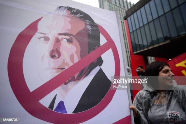 Demonstrators protest against Brazilian President Michel Temer along Paulista Avenue in Sao Paulo Brazil on May 21 2017 Temer faced growing pressure...
