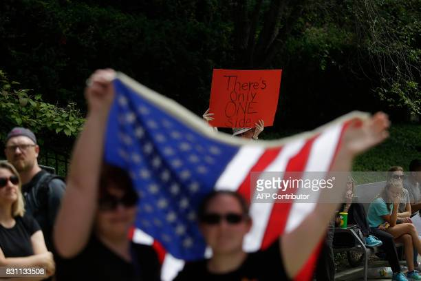 Demonstrators protest against hate white supremacy groups and President Donald Trump on Sunday August 13 2017 in Chicago Illinois Protesters were...
