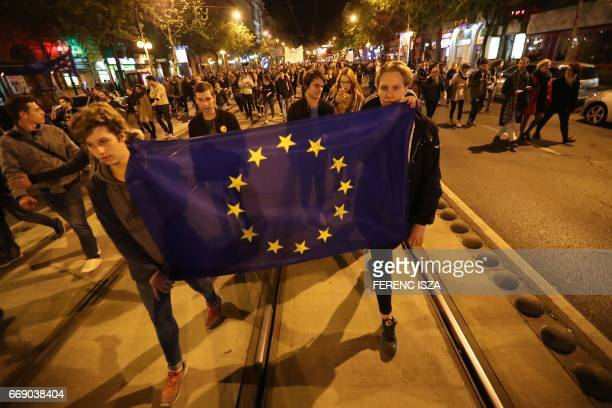 Demonstrators protest against Hungarian Prime Minister Viktor Orban's government on Margit round avenue on April 15 2017 in downtown Budapest...