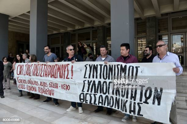 Demonstrators protest against real estate auctions outside Thessaloniki's courthouse on June 21 2017 A tacit ban on thousands of property...