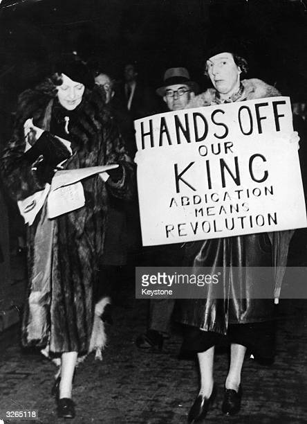 Demonstrators protest against the abdication of King Edward VIII threatened on account of hostility towards his proposed marriage to US socialite and...