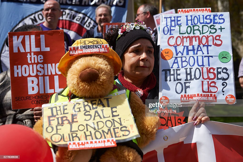 Demonstrators protest against the governments housing bill outside the Houses of Parliament in central London on May 3, 2016. Activists from the Kill the Housing Bill campaign decended on Parliament Square to protest the bill that they say will adversely effect social tenants. / AFP / NIKLAS HALLE'N