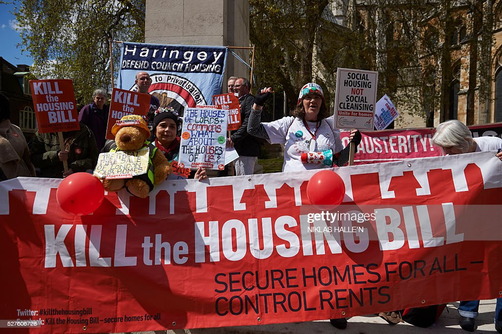 Demonstrators protest against the governments housing bill outside the Houses of Parliament in central London on May 3, 2016. Activists from the Kill the Housing Bill campaign decended on Parliament Square to protest the bill that they say will adversely effect social tenants and to call for secure homes for all and rent controls. / AFP / NIKLAS HALLE'N