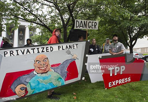 Demonstrators protest against the legislation to give US President Barack Obama fasttrack authority to advance trade deals including the TransPacific...