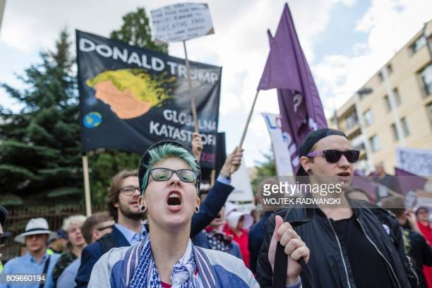 Demonstrators protest against the visit of US President Donald Trump in Warsaw on July 6 2017 Donald Trump embarks on a highstakes visit to Europe...