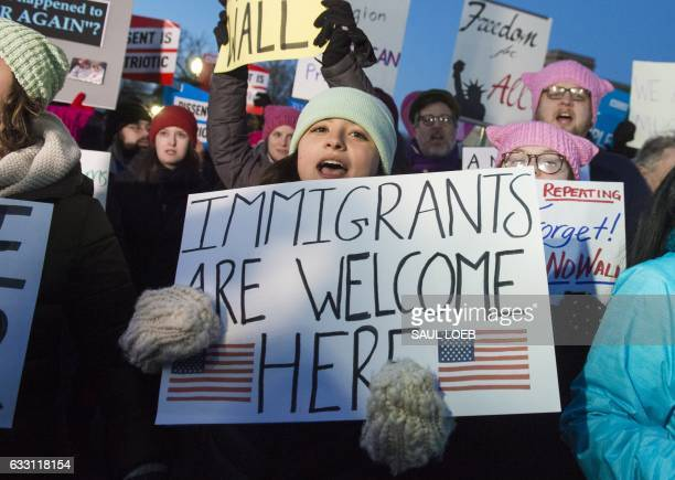 TOPSHOT Demonstrators protest against US President Donald Trump and his administration's ban of travelers from 7 countries by Executive Order during...