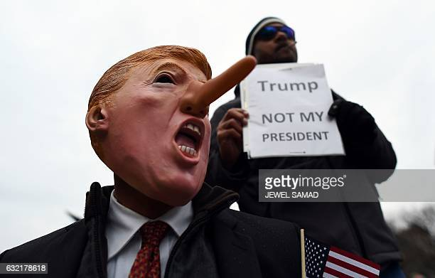 Demonstrators protest against US Presidentelect Donald Trump before his inauguration on January 20 in Washington DC Donald Trump will be sworn in as...