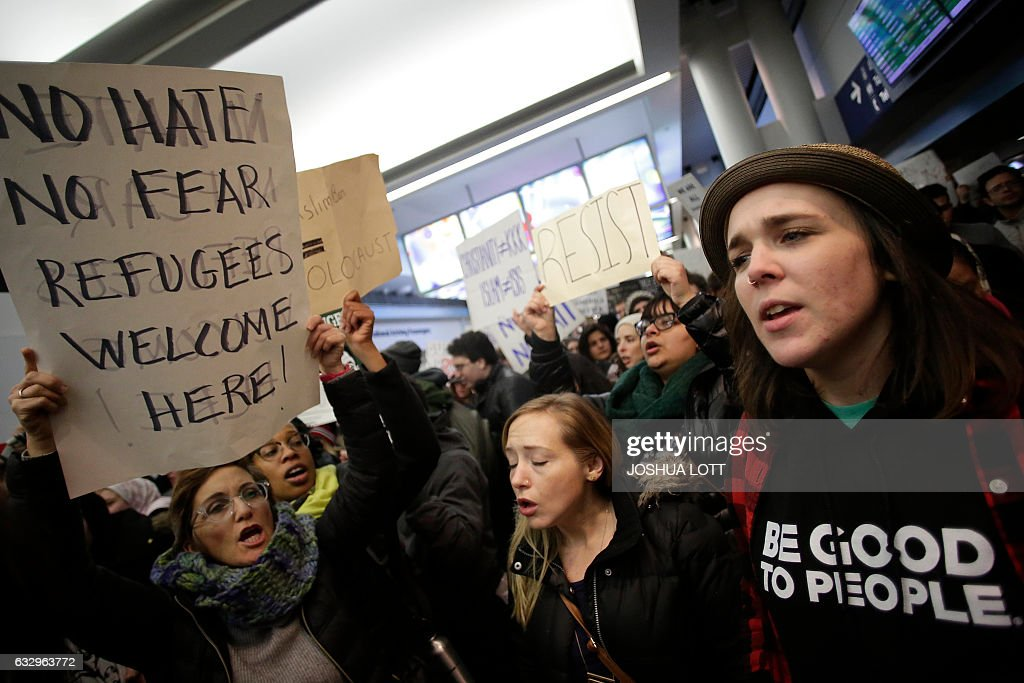 Demonstrators protest agaist President Trump's executive immigration ban at Chicago O'Hare International Airport on January 28, 2017. US President Donald Trump signed the controversial executive order that halted refugees and residents from predominantly Muslim countries from entering the United States. Trump boasted Saturday that his 'very strict' crackdown on Muslim immigration was working 'very nicely,' amid mounting resistance to the order which has been branded by many as blatantly discriminatory. / AFP / Joshua LOTT
