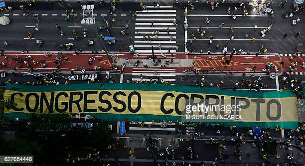 TOPSHOT Demonstrators protest along Paulista Avenue in Sao Paulo Brazil on December 4 2016 against corruption and in support of the Lava Jato...