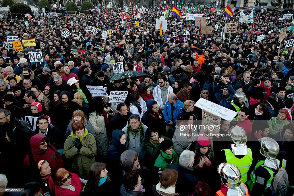 Demonstrators protest at Neptuno Square during a march by thousands of people on February 23, 2013 in Madrid, Spain. Public health workers, civil servants and disaffected citizens converged on central Madrid to protest against the austerity measures of Prime Minister Mariano Rajoy.