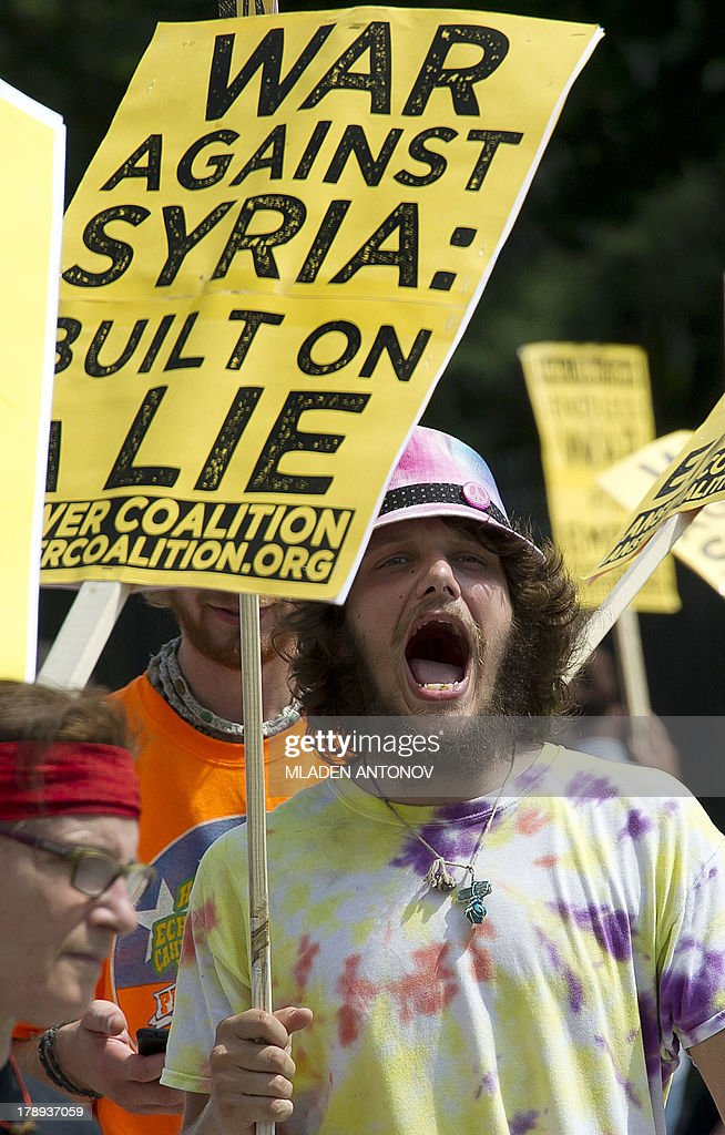 Demonstrators protest during a rally against a possible US attack on Syria in response to alleged use of chemical weapons by the Assad government, in Lafayette Park in front of the White House in Washington, DC on August 31, 2013. US President Barack Obama said Saturday he will ask the US Congress to authorize military action against Syria, lifting the threat of immediate strikes on President Bashar al-Assad's regime. Obama said he had decided he would go ahead and launch military action on Syria, but he believed it was important for American democracy to win the support of lawmakers.