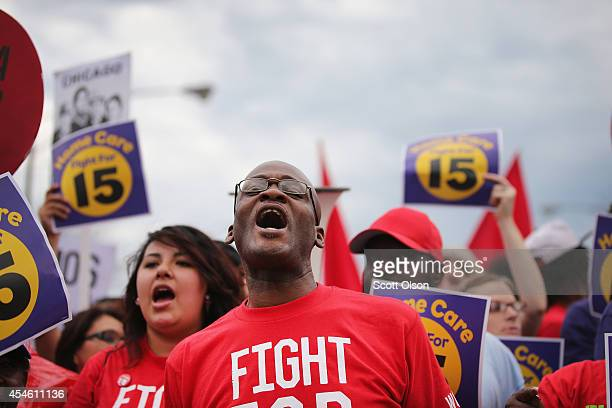 Demonstrators protest for an increase in wages for fast food and home care workers during the morning rush hour on September 4 2014 in Chicago...