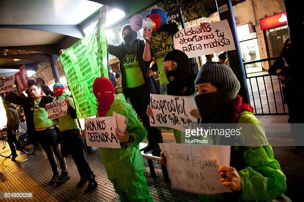 Demonstrators protest in favor of abortion in Santiago del Chile on July 25 2013 The march was concluded in the Catedral of Santiago and the...